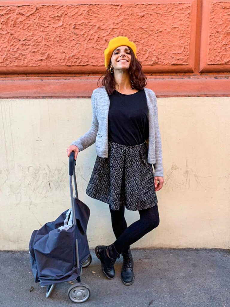 smiling girl with a yellow hat going shopping in Rome