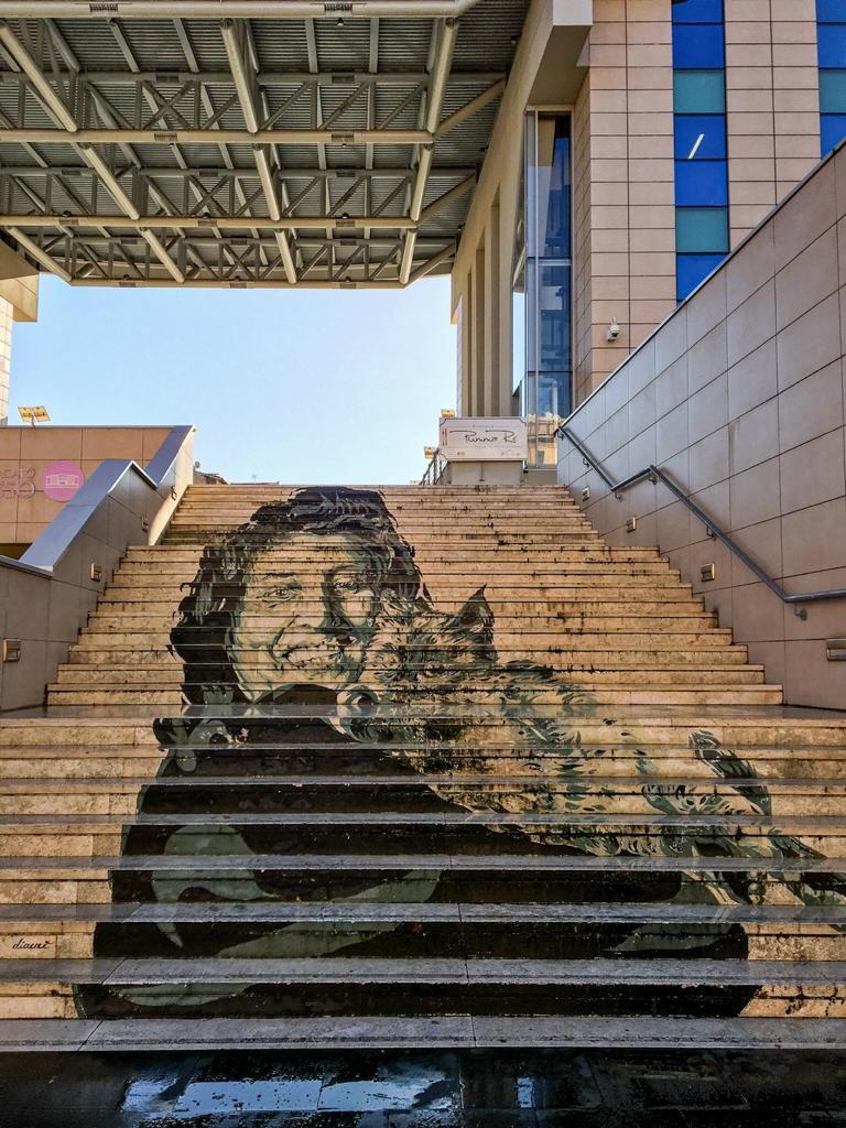 staircase with Anna Magnani picture outside Trionfale Market in Rome